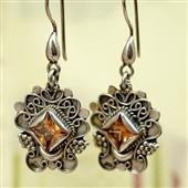 Orientalne srebrne kolczyki z topazem