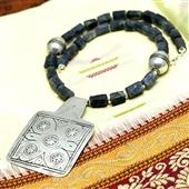 Surowy szafir i duży srebrny wisior Berber