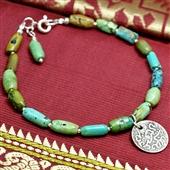 Turkusowa bransoletka z arabską monetą